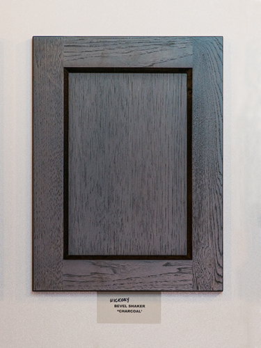 A Hickory Kitchen Cabinet Door In The Charcoal Finish