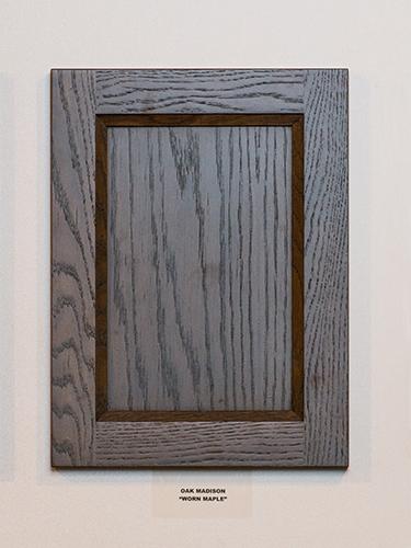 An oak kitchen cabinet door, in the Worn Maple finish