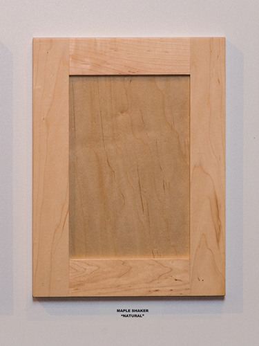 A maple kitchen cabinet door, in the Natural finish