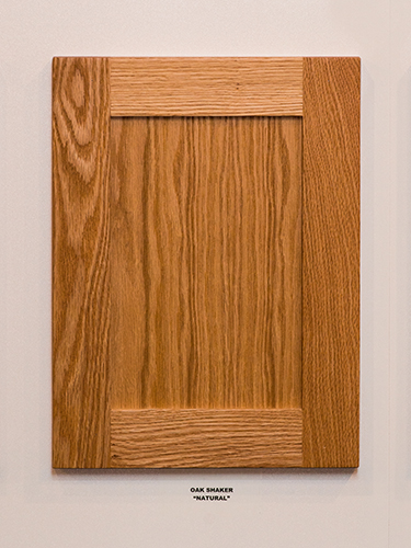 An oak kitchen cabinet door, in the Natural finish