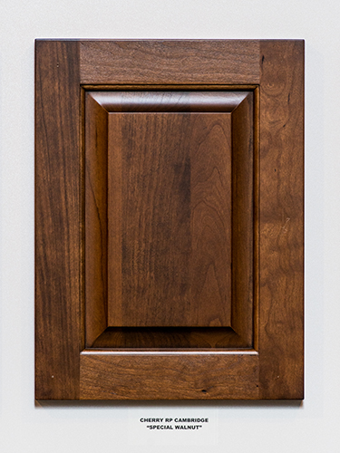 A cherry kitchen cabinet door, in the Special Walnut finish