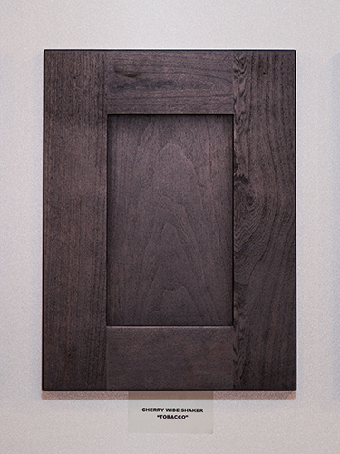 A cherry kitchen cabinet door, in the Tobacco finish
