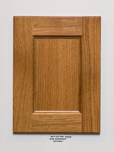 A white oak kitchen cabinet door, in the Natural finish