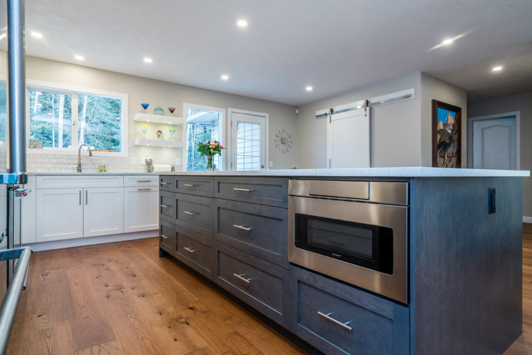 This kitchen island features an oven
